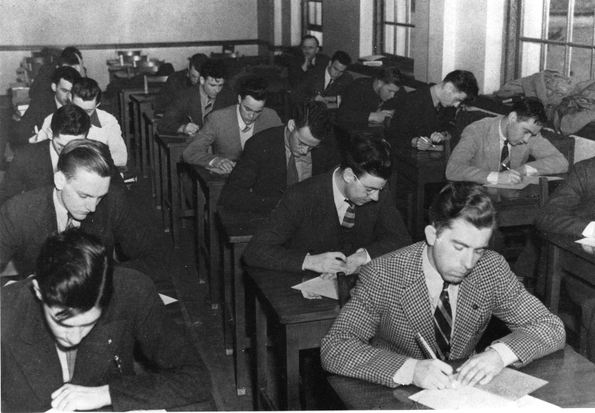 Students wearing coats and ties, 1940