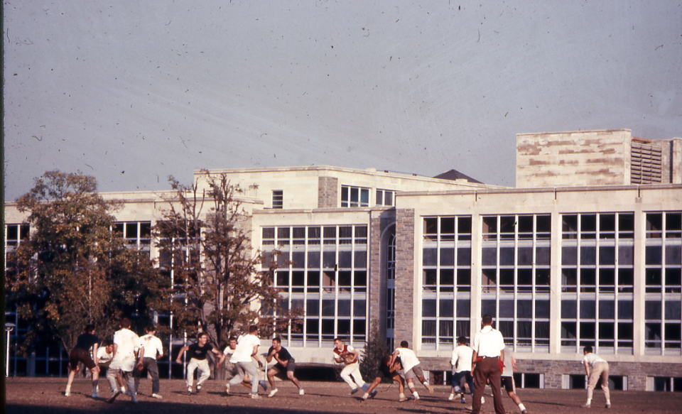 Students playing intramural on Mendel Field, 1968.