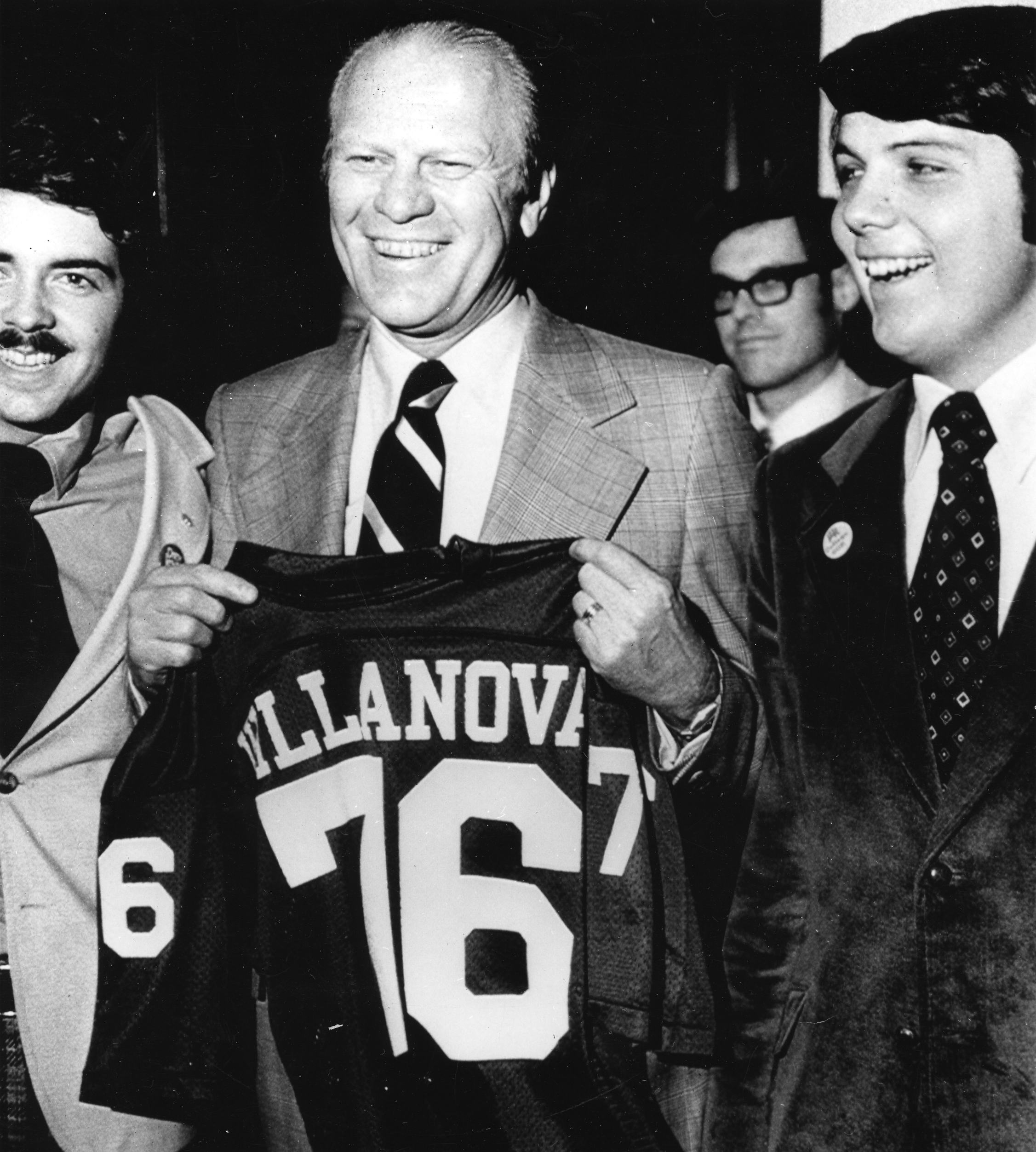 President Gerald R. Ford displays Villanova football jersey